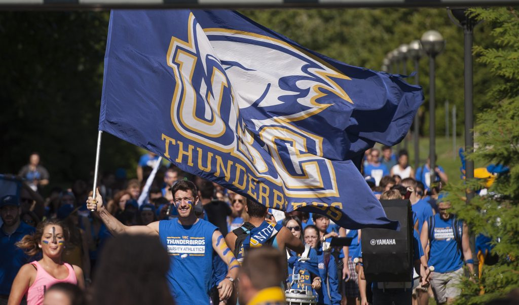 Chris Howe waving the flag on the first Great Thunderbird Trek to Homecoming
